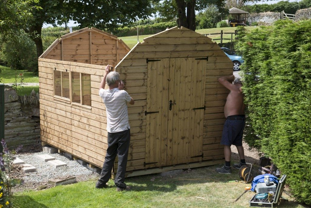 Men building a container shed