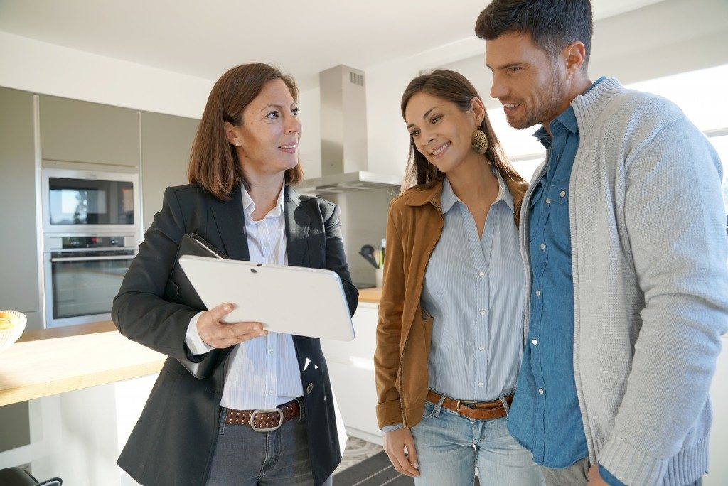 couple checking home features as they prepare to purchase a home