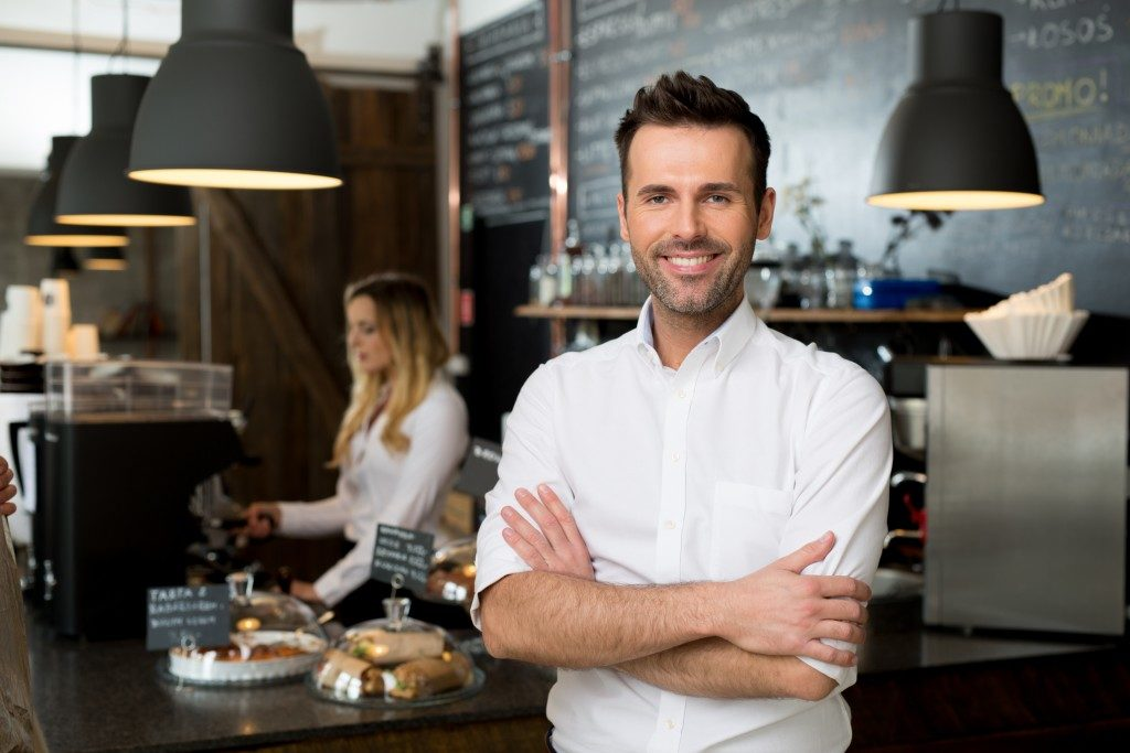 Successful small business owner standing with crossed arm