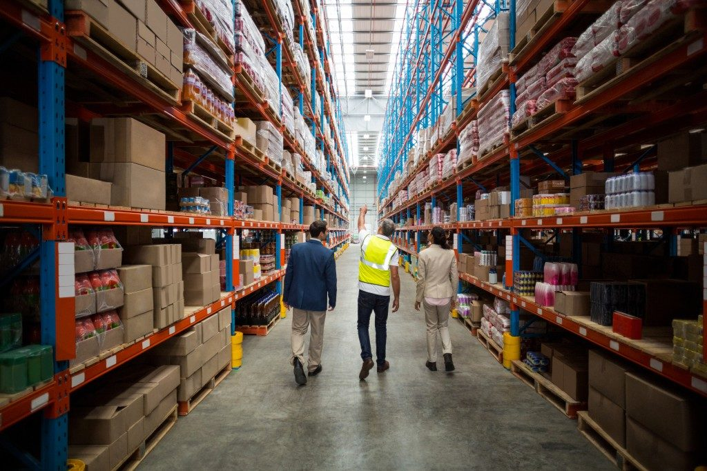 Logistics employees walking in the warehouse