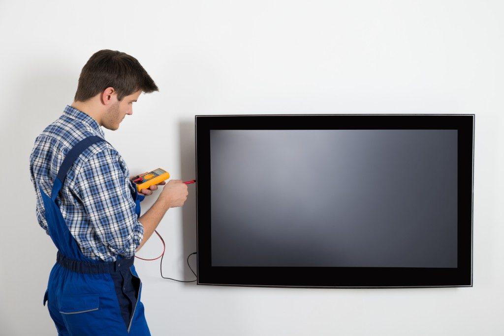 Technician repairing a TV