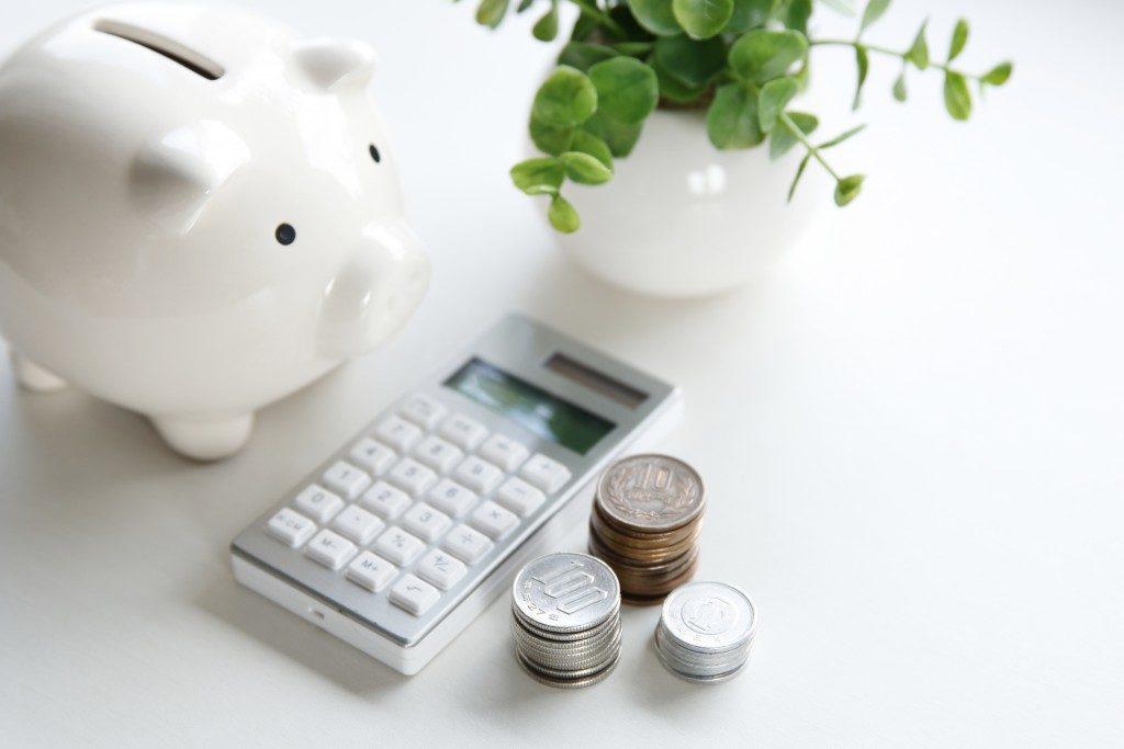 coins, calculator, and a piggy bank