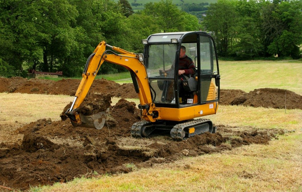 small digger preparing land for garden