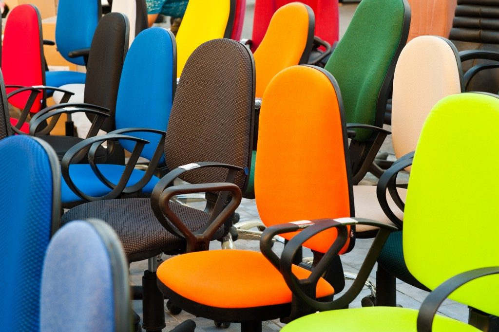 Group of colored office chairs