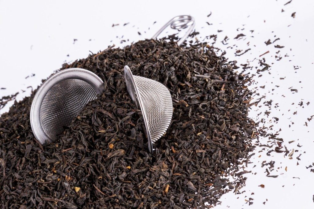 Black tea and tea strainer