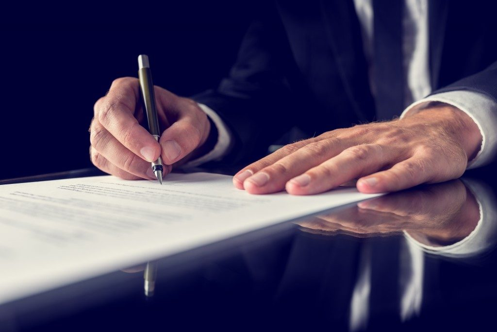 signing important insurance document