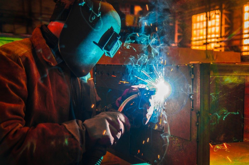 man welding something