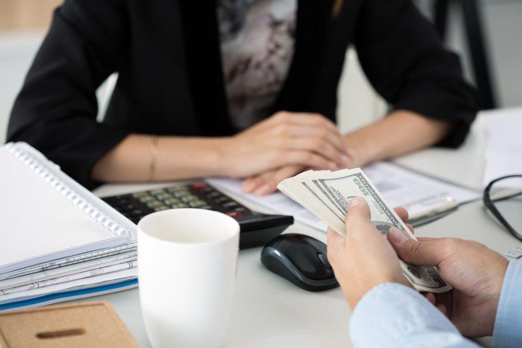 Bank employee holding money