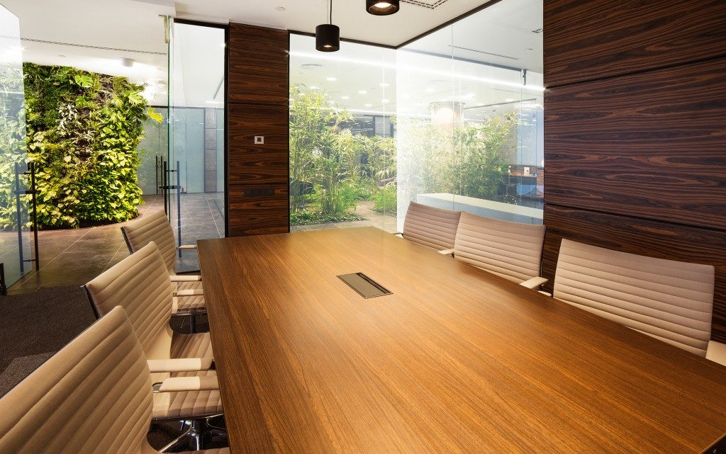 office space with meeting room and plants