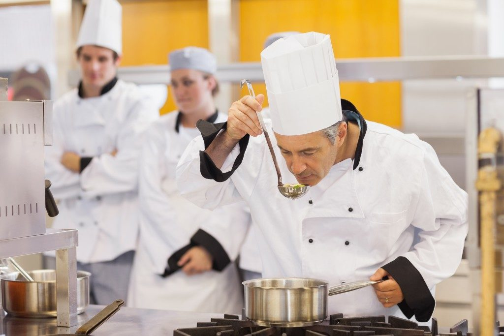 chef tasting the dishes