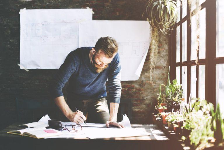 man creating plans at work