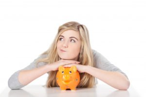 young woman and her piggy bank
