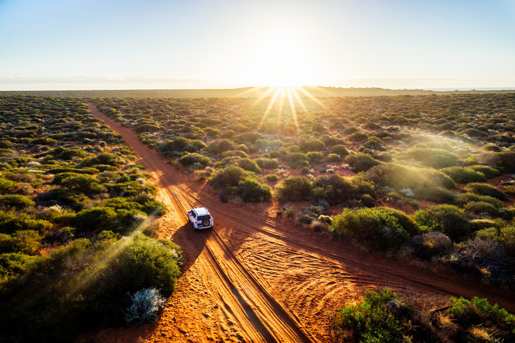 red sand unpaved road
